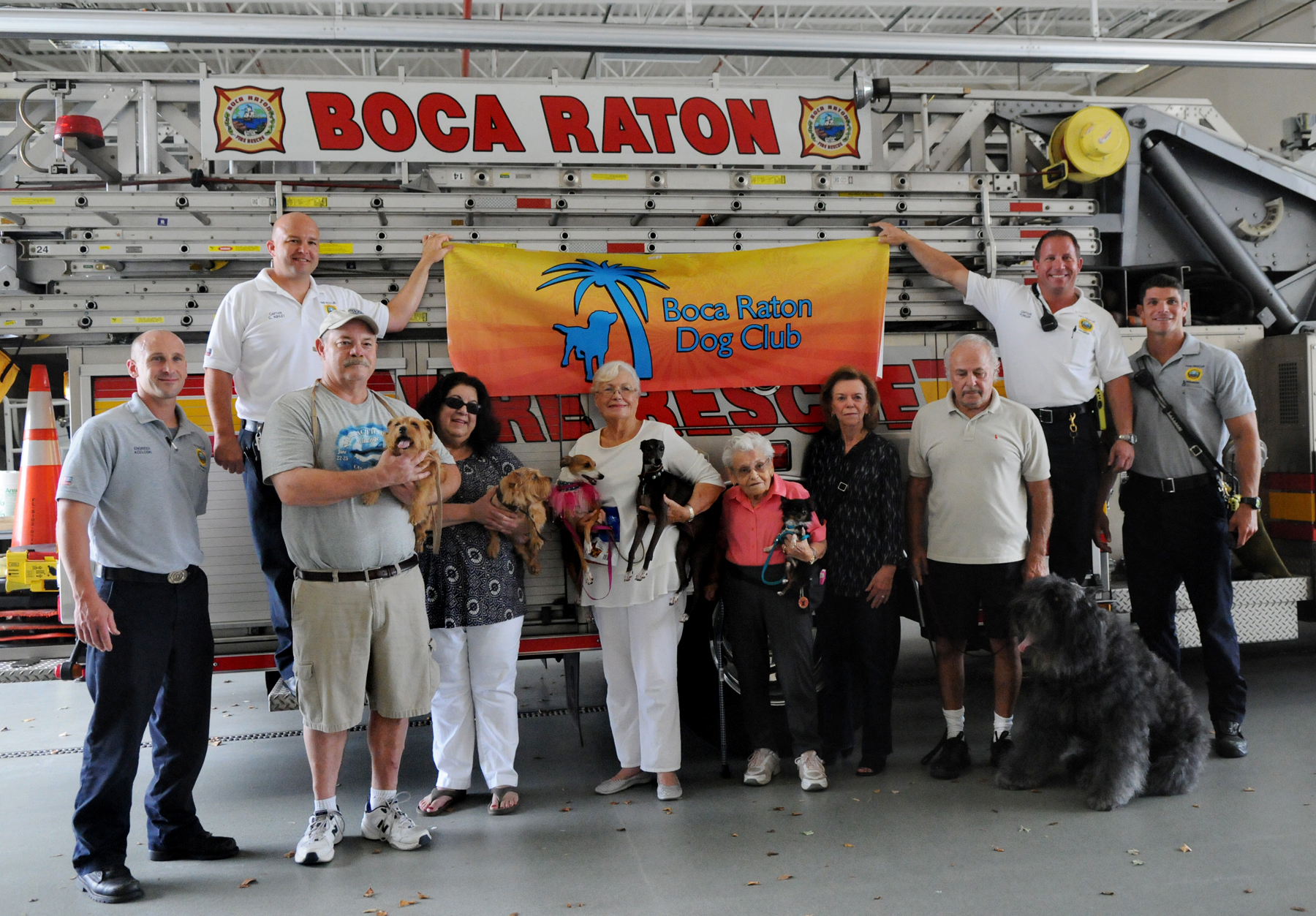 FPG-BRF-FIREDOG-0812a FPG photo/Marta Mikulan Martin 7/31/15 July 31 2015: The Boca Raton Dog Club was donating pet oxygen mask to Boca Raton Fire Rescue. The club is doing with profits from their recent American Kennel Club Dog Show.. At Fire Station #5, members of the club and squad members are sharing a photo to celebrate the donation.
